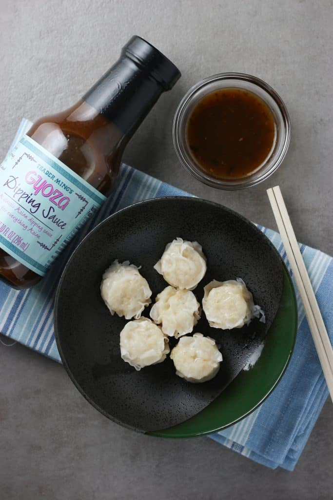 Trader Joe's Gyoza Dipping Sauce pictures with shumai and chopsticks