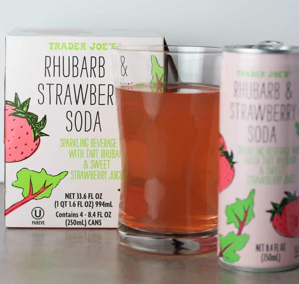 Trader Joe's Rhubarb and Strawberry Soda soda box, can, and soda in a glass.
