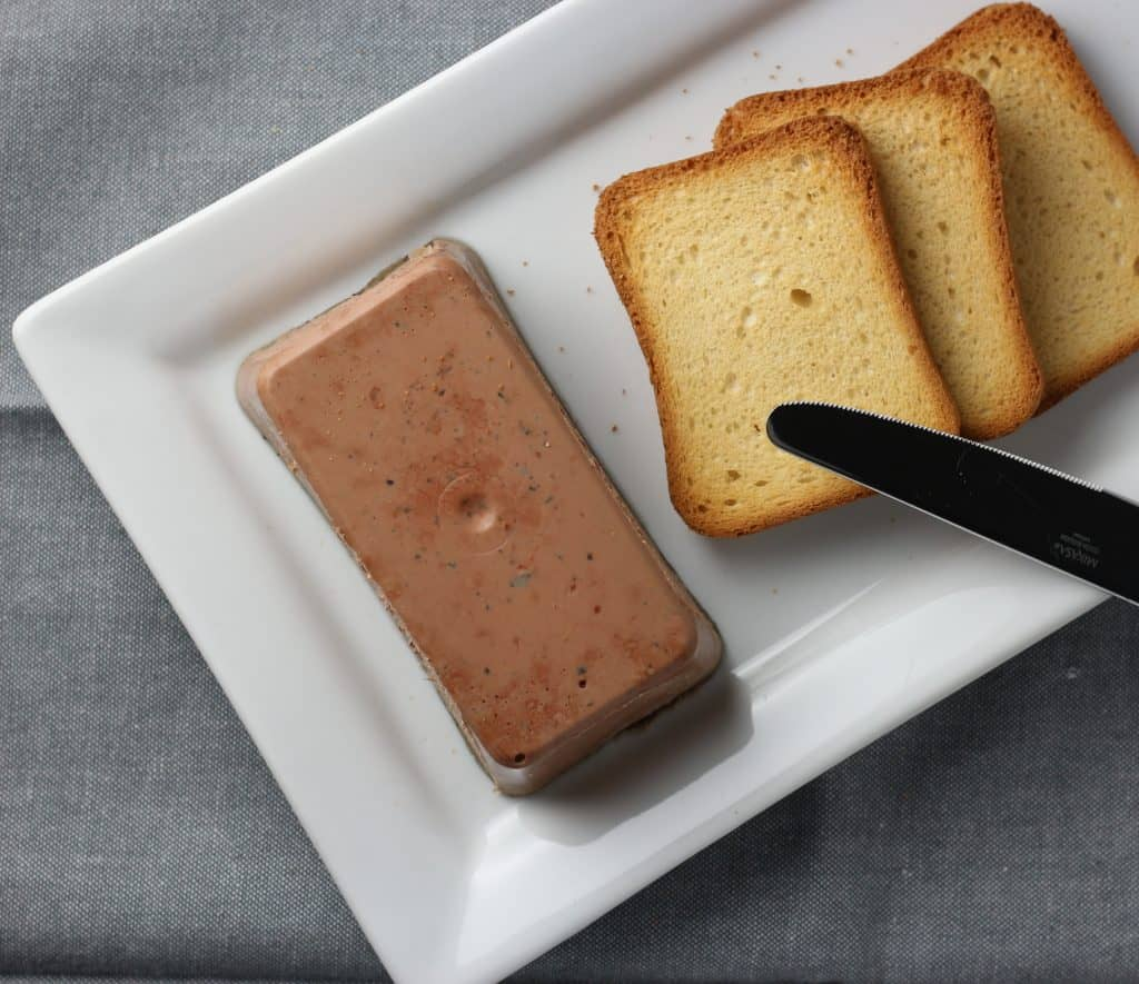 Trader Joe's Brioche Toasts pictured next to Trader Joe's Truffle Mousse Pate