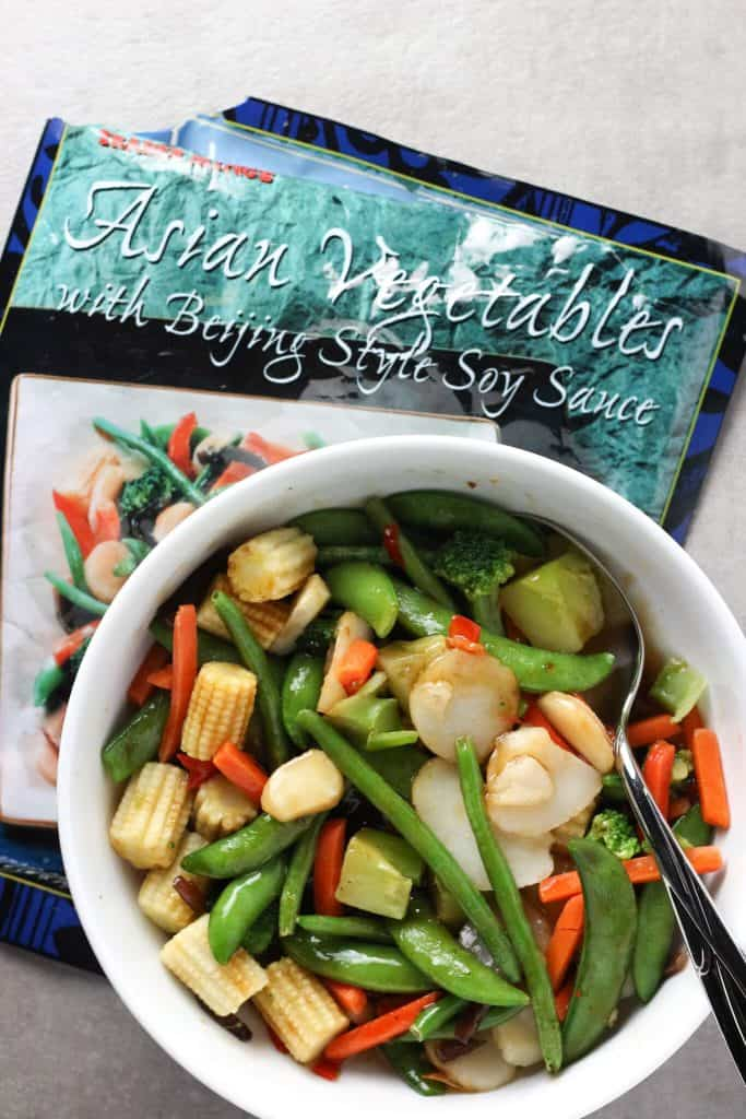 Trader Joe's Asian Vegetables with Beijing Soy Sauce in a white bowl with a grey background