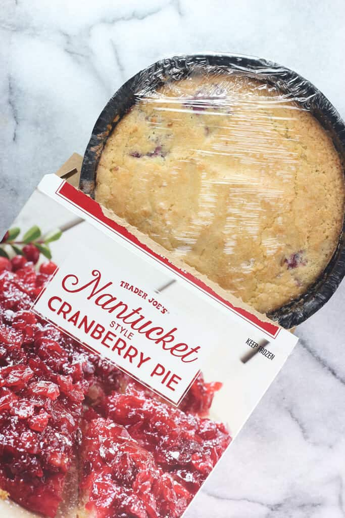 Trader Joe's Nantucket Style Cranberry Pie out of the box showing the pie is actually upside down when removed
