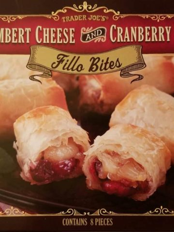 An unopened box of Trader Joe's Camembert Cheese and Cranberry Sauce Fillo Bites