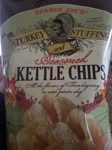 An unopened bag of Trader Joe's Turkey Stuffing and Seasoned Kettle Chips