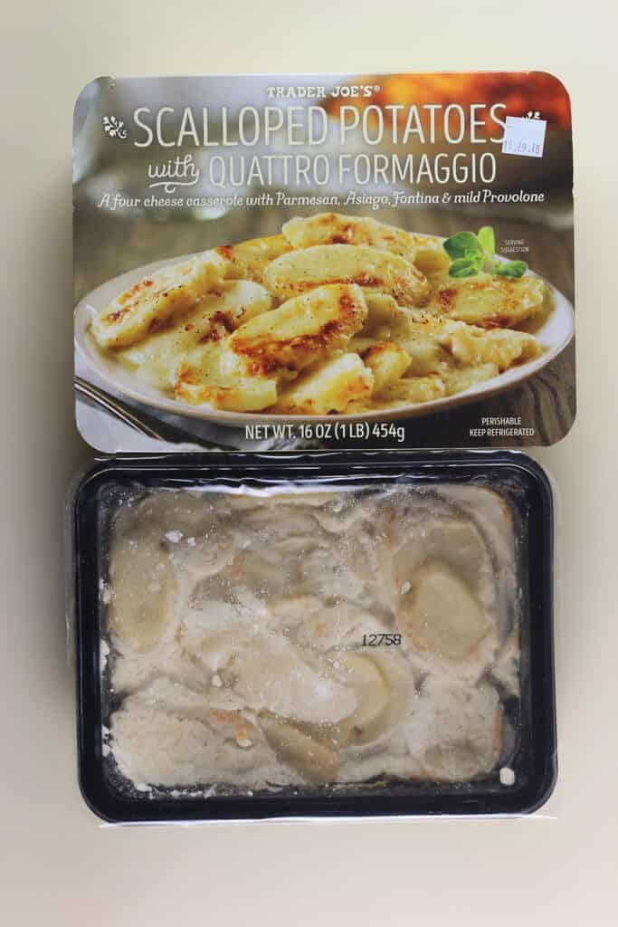 An open package of Trader Joe's Scalloped Potatoes with Quattro Formaggio showing the contents