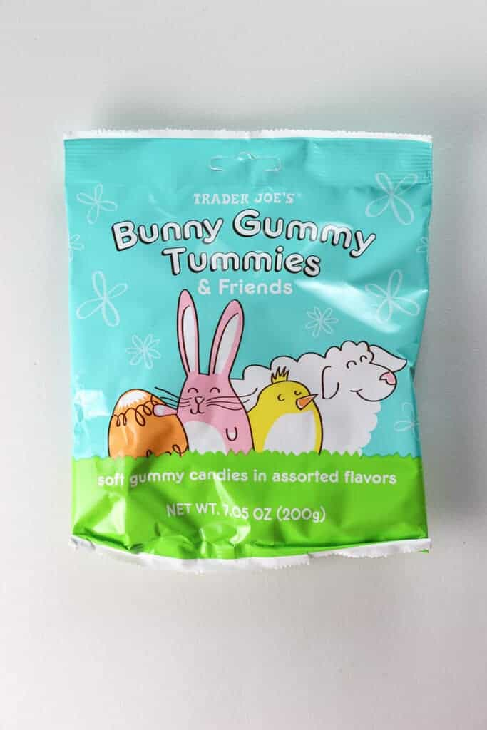 An unopened bag of Trader Joe's Bunny Gummy Tummies on a white background
