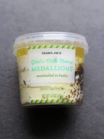 An unopened package of Trader Joe's Goat's Milk Cheese Medallions Marinated in Herbs