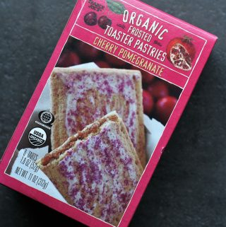 Trader Joe's Organic Frosted Cherry Pomegranate Toaster Pastries on a dark surface