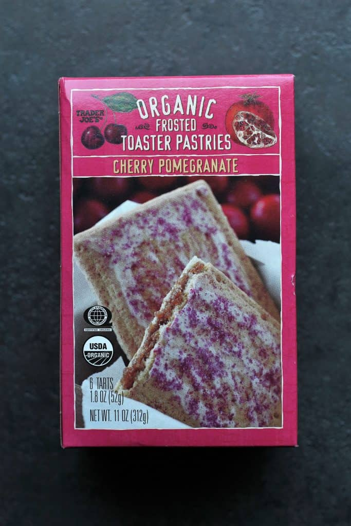 Trader Joe's Organic Frosted Cherry Pomegranate Toaster Pastries box on a dark surface