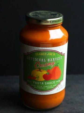 An unopened jar of Trader Joe's Autumnal Harvest Creamy Pasta Sauce