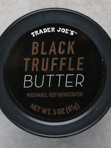 An unopened Trader Joe's Black Truffle Butter