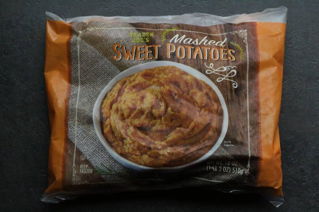 An unopened bag of Trader Joe's Mashed Sweet Potatoes