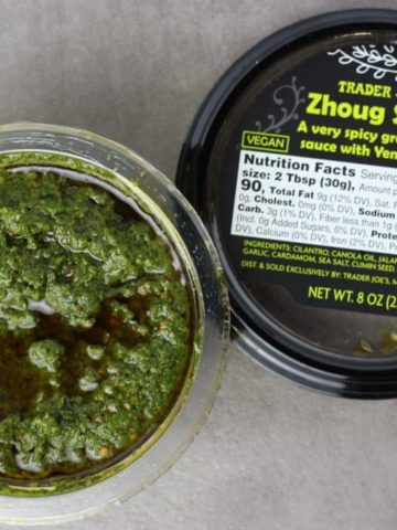 Trader Joe's Zhoug Sauce opened revealing the green sauce