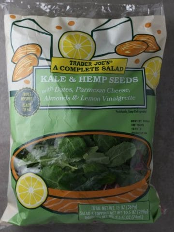 Trader Joe's A Complete Salad Kale and Hemp Seeds bag on a grey background