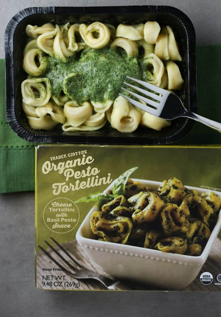 Trader Joe's Organic Pesto Tortellini just out of the microwave with fork on top