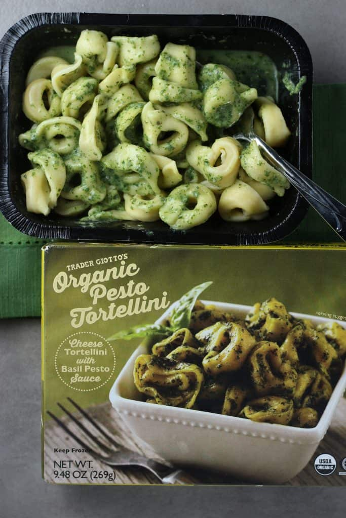 Trader Joe's Organic Pesto Tortellini mixed together pictured with the final product above the box.