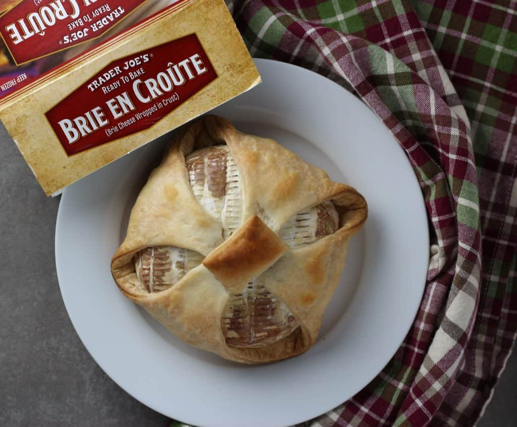 Trader Joe's Brie En Croute baked, next to the box and napkin