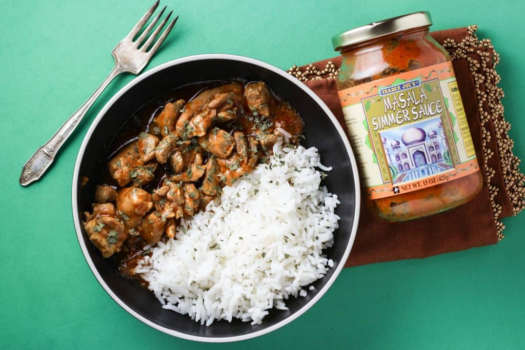 Trader Joe's Masala Simmer Sauce plated next to the jar