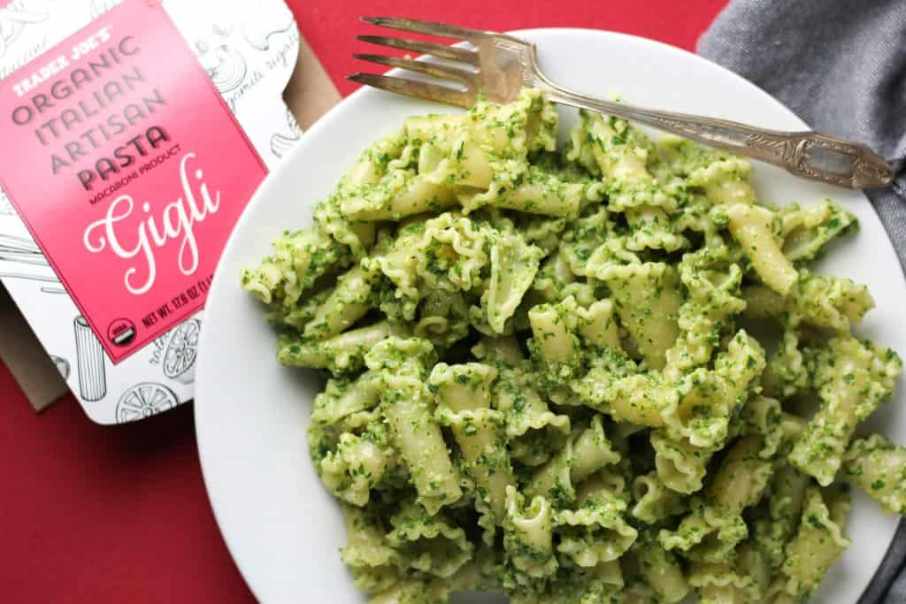 Trader Joe's Organic Italian Artisan Pasta Gigli with pesto on a red background with a grey napkin