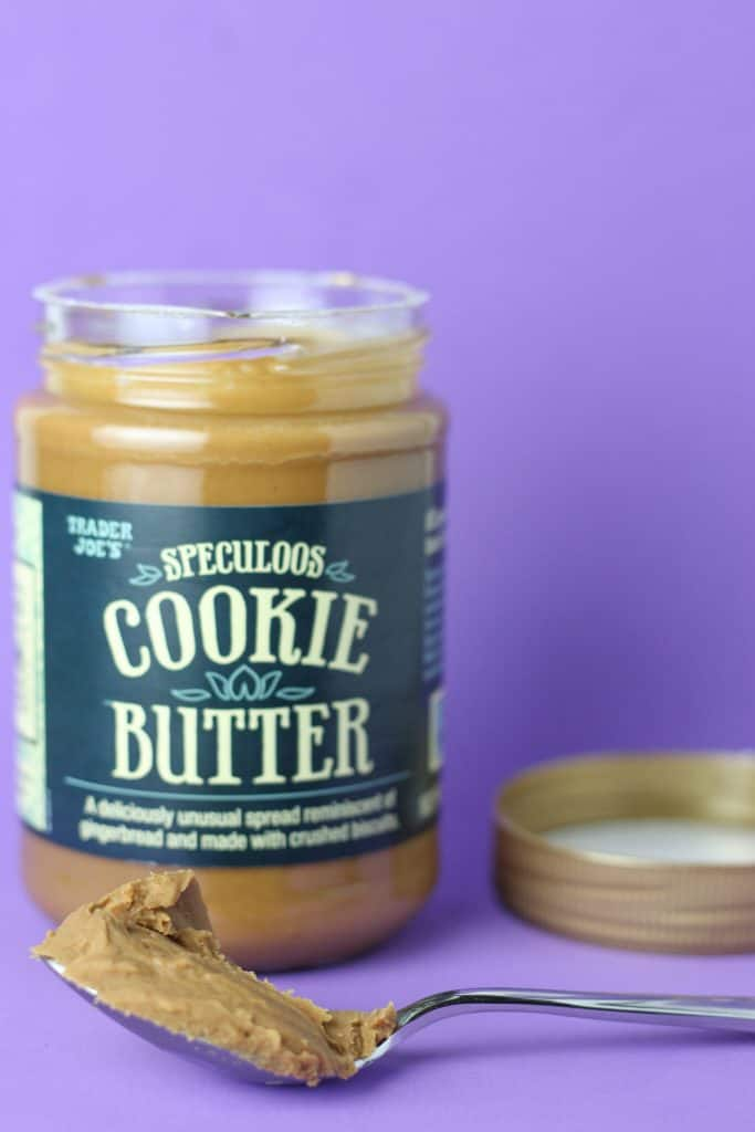 Trader Joe's Speculoos Cookie Butter with a spoon of cookie butter next to an open jar.