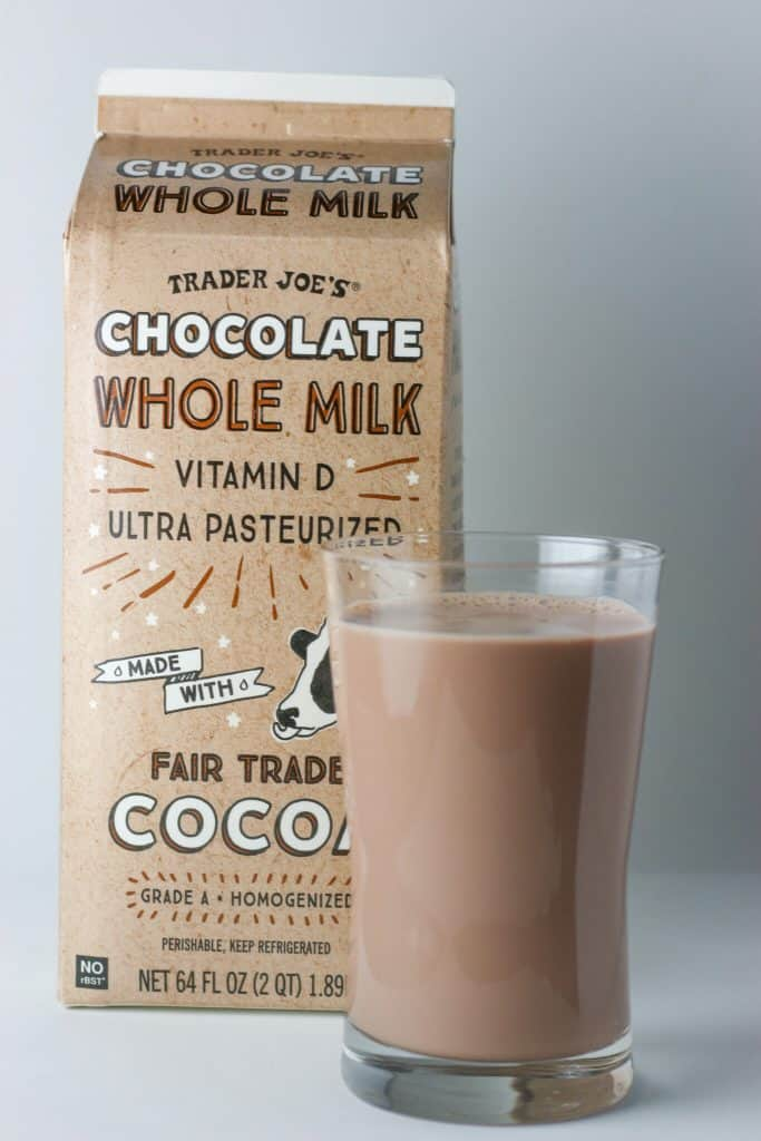 Trader Joe's Chocolate Whole Milk in a glass next to the package