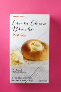 An unopened package of Trader Joe's Cream Cheese Brioche Pastries box