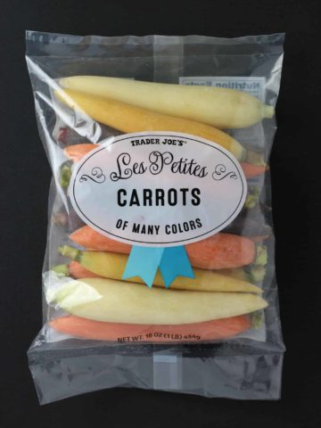 An unopened bag of Trader Joe's Les Petites Carrots of Many Colors