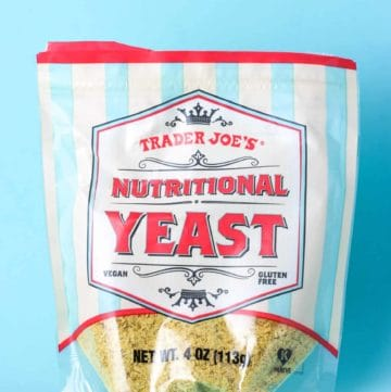 Trader Joe's Nutritional Yeast package on a blue background