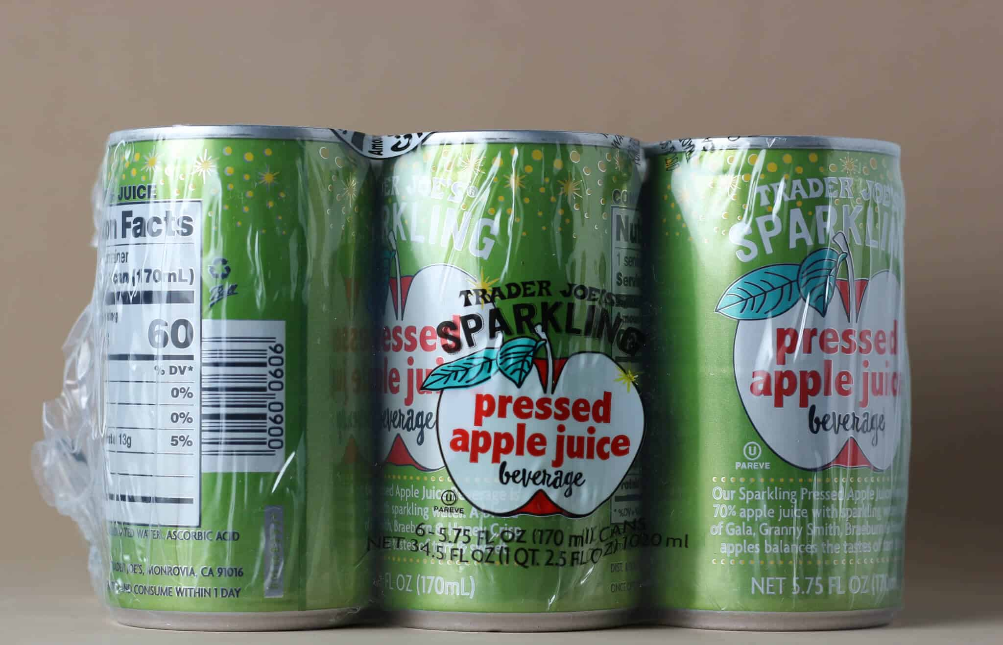 Trader Joe's Sparkling Pressed Apple Juice Beverage cans in a six pack