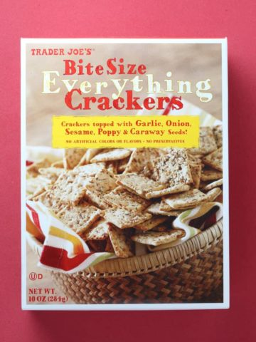 Trader Joe's Bite Size Everything Crackers box on a red background