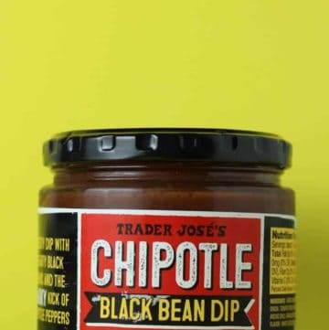 Trader Joe's Chipotle Black Bean Dip on a yellow background