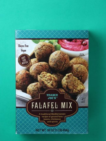 An unopened box of Trader Joe's Falafel Mix on a green background