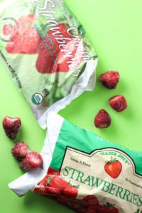 Trader Joe's Frozen Organic Strawberries and regular strawberries side by side
