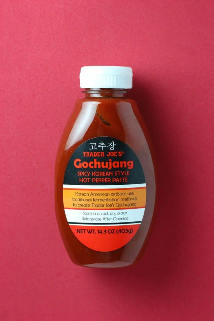 Trader Joe's Gochujang bottle on red background