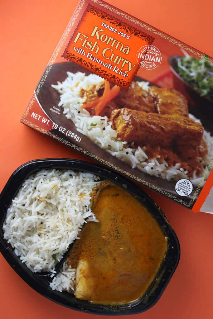 Trader Joe's Korma Fish Curry cooked via the microwave and next to the original packaging