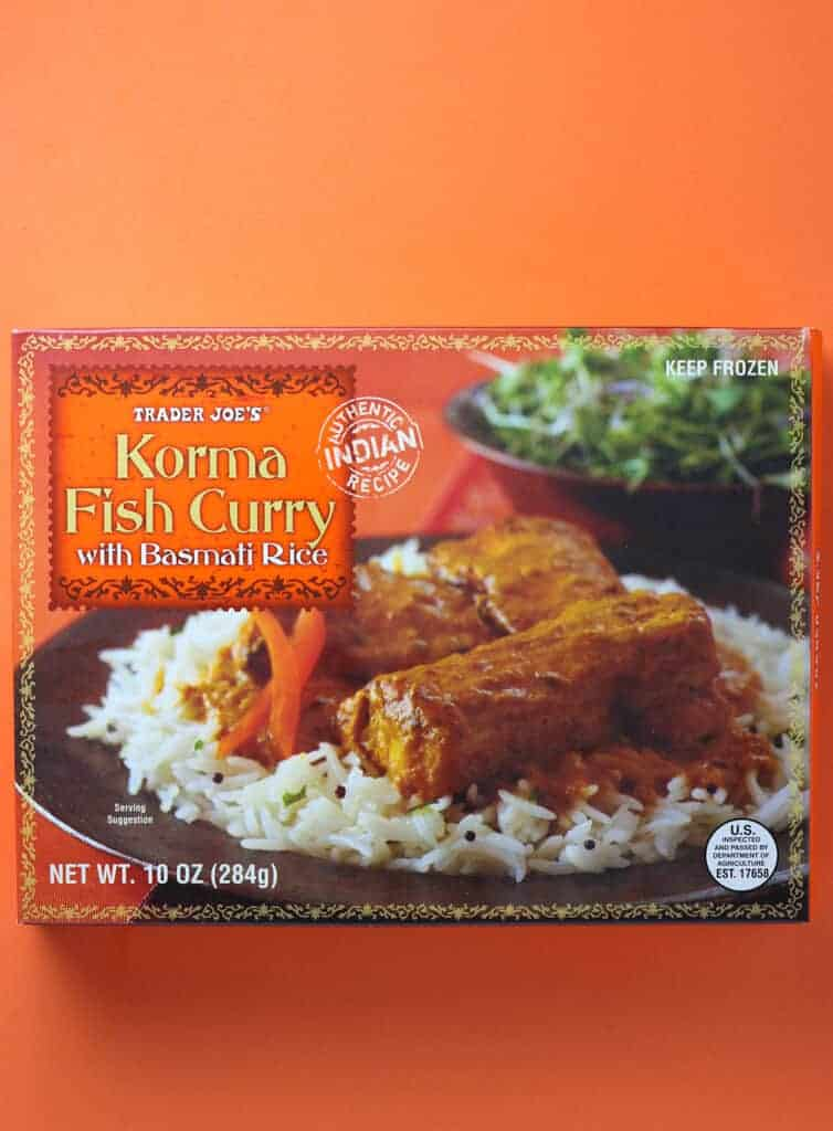 Trader Joe's Korma Fish Curry box as sold in stores on an orange background
