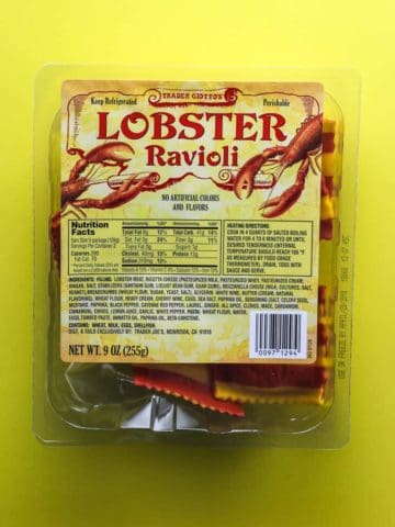 Trader Joe's Lobster Ravioli package on a yellow background