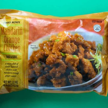 Trader Joe's Mandarin Orange Chicken bag on an orange background