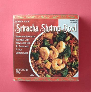 Trader Joe's Sriracha Shrimp Bowl package on a red background