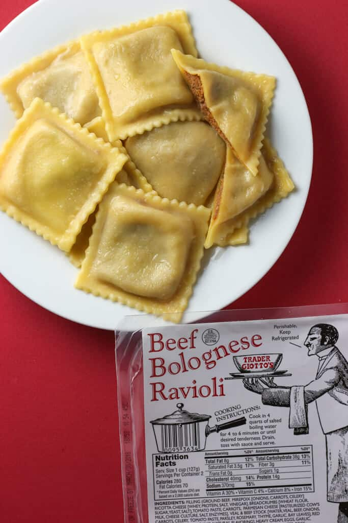 Trader Joe's Beef Bolognese Ravioli cooked with one cut in half to reveal the insides