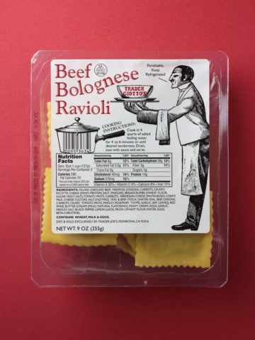Trader Joe's Beef Bolognese Ravioli box on a red background