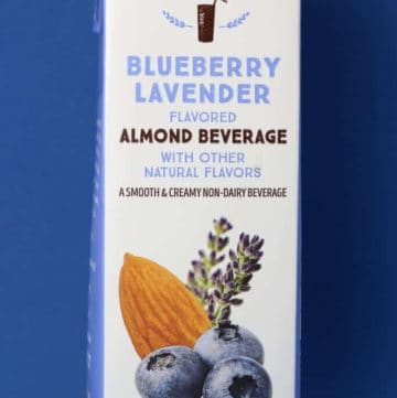 Trader Joe's Blueberry Lavender Flavored Almond Beverage package on a blue background.