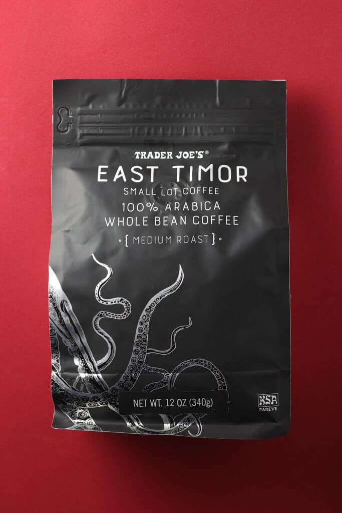 Trader Joe's East Timor Small Lot Coffee bag on a red background