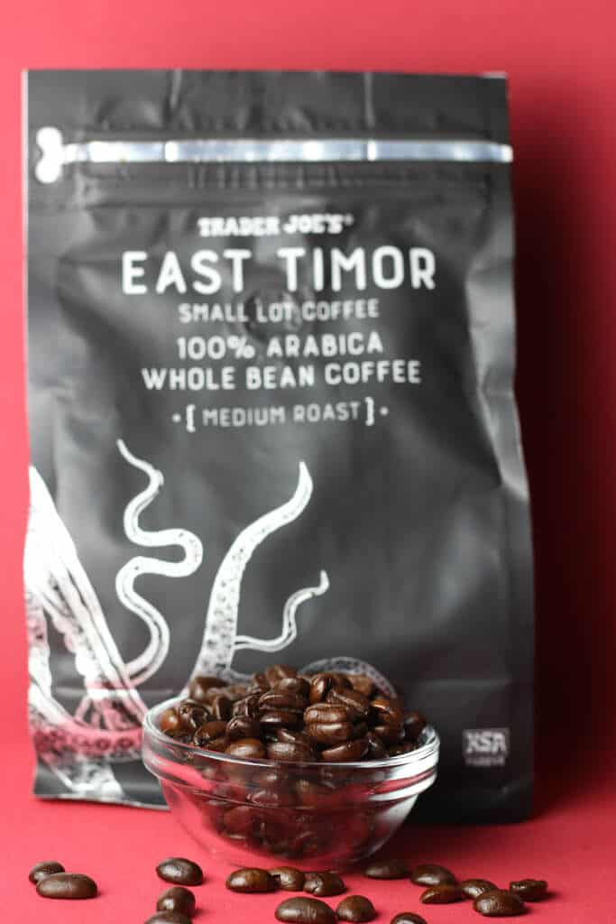 Trader Joe's East Timor Small Lot Coffee beans next to the bag