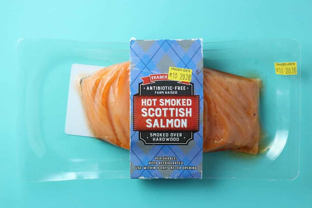 Trader Joe's Hot Smoked Scottish Salmon package on a blue background