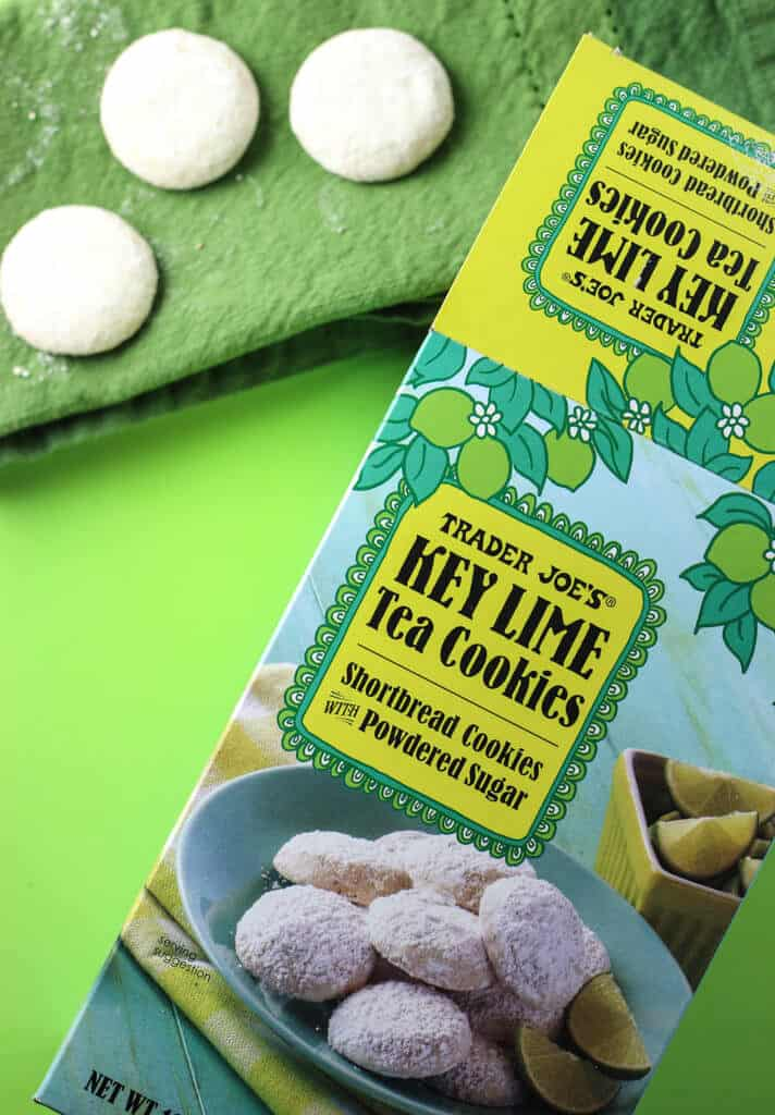 Trader Joe's Key Lime Tea Cookies on a green background next to the original box.
