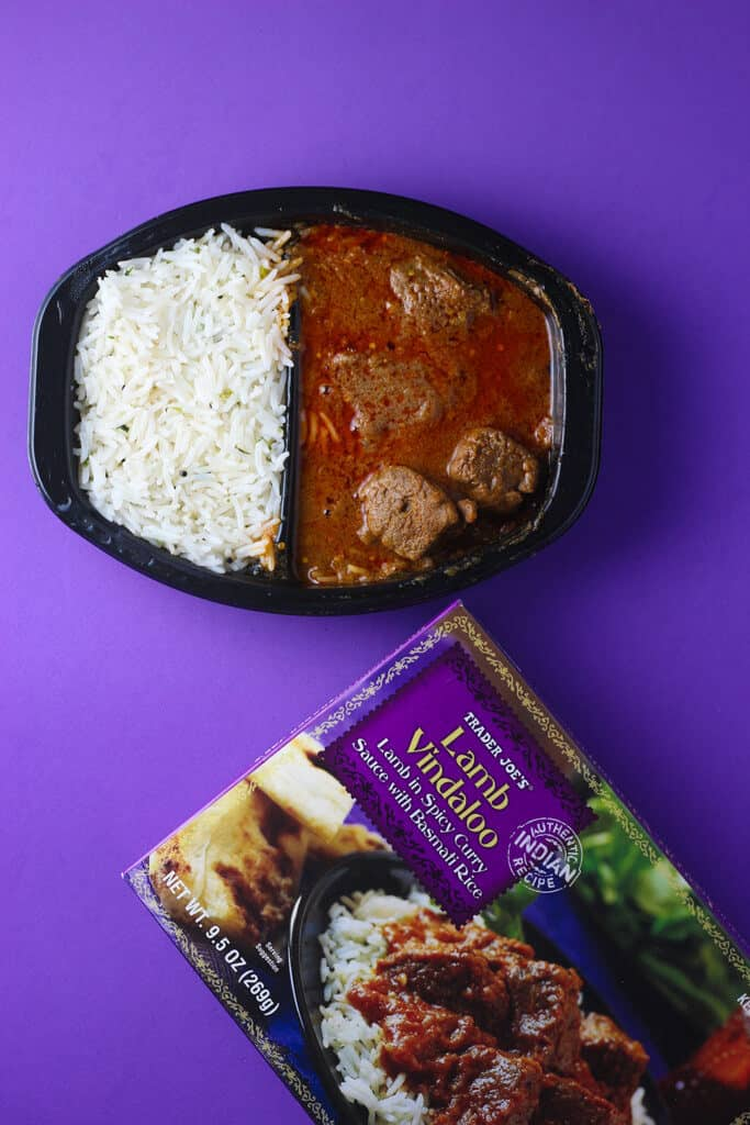 Trader Joe's Lamb Vindaloo fully cooked on a purple background