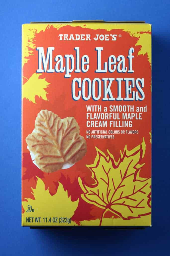 Trader Joe's Maple Leaf Cookies box on a blue surface.