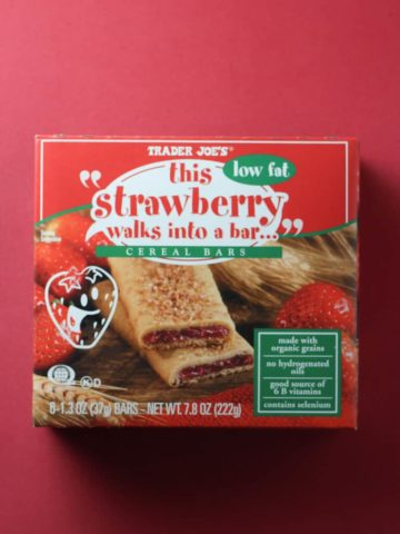 Trader Joe's This Strawberry Walks Into a Bar Cereal Bars box on a red background