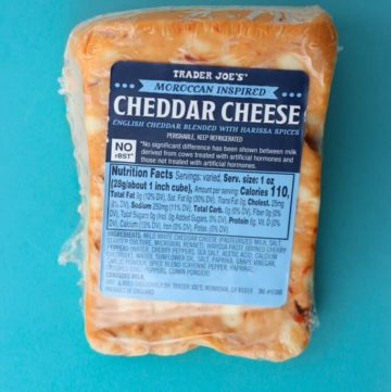 An unopened package of Trader Joe's Moroccan Inspired Cheddar Cheese