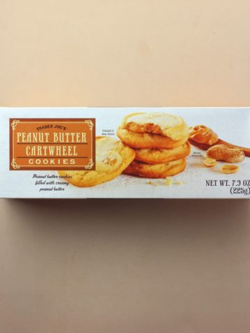 An unopened box of Trader Joe's Peanut Butter Cartwheel Cookies box